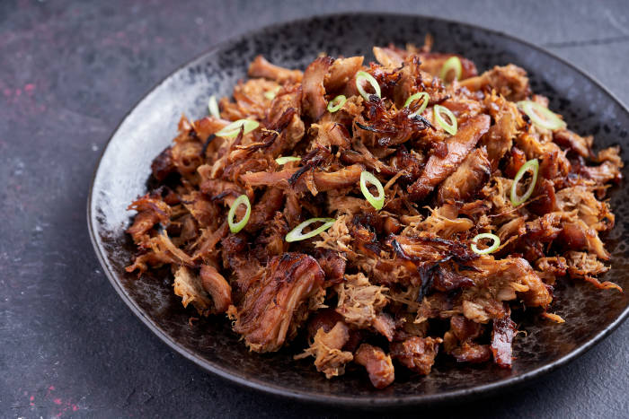 3-ingredient slow cooked hoisin chicken topped with spring onions