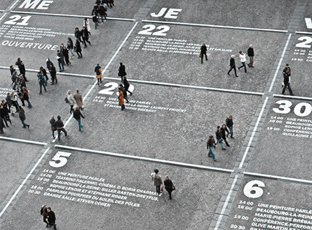 Calendar on the street with people walking