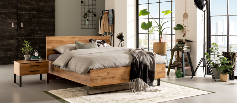 Rustic bed in fancy appartment