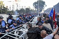 Anti-Al-Qa'ani protesters put...