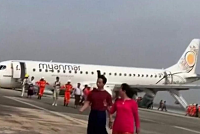 Myanmar airplanes fly aboard a forced...
