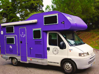 Amália – Go on adventure with this amazing purple van  (Located in Portugal)