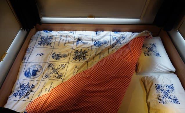 Tricolore – Luxe camper met airco+navigatie voor gezin met (grote) kinderen
