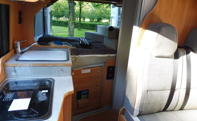 Comfortable Pössl bus camper with fixed bed