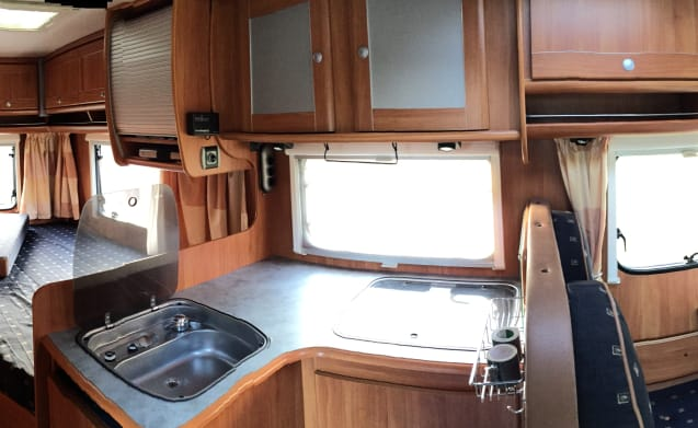 Unique family camper equipped for a holiday.