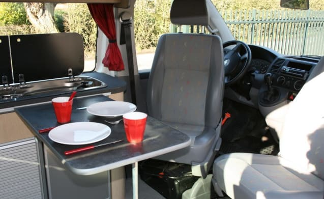 Modern VW T5 with lifting roof, ideal for 2 to 4 people!