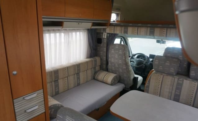 Compact, reliable and yet spacious Hymer alcove camper at Emmen