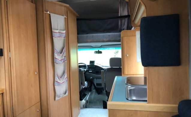 Neat comfortable camper with round seat