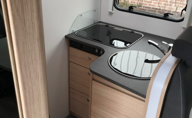 Luxury motorhome with 2-person queen bed!