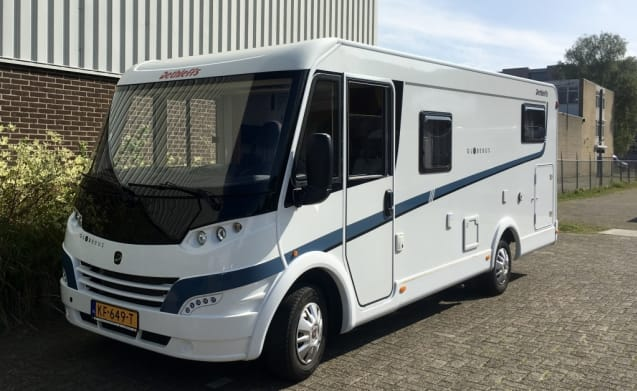 Luxurious, complete camper with length beds and a pull-down bed!
