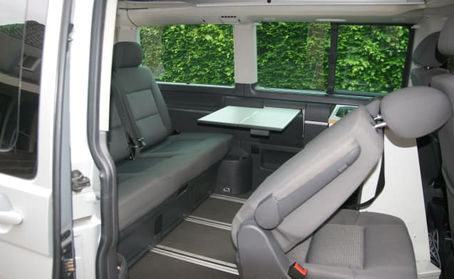 Delicious Compact VW camper bus (7 pers) with sleeping lift roof and bicycle rack