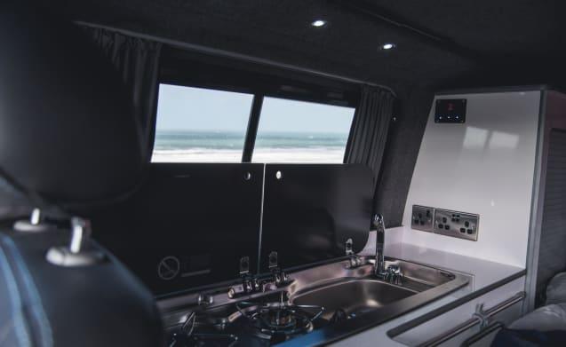 Cosmo, classic style T5 surf van sleeping 4
