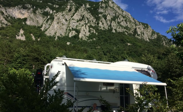 Spacious family camper with fixed double alcove bed and bunk bed