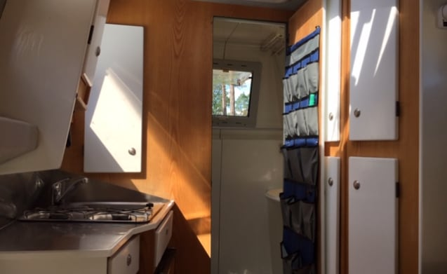 Split level bus camper, the ideal motorhome for 2 people with a separate bed.