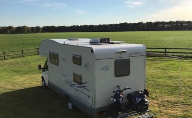Spacious 7-person camper with air conditioning and bicycles.