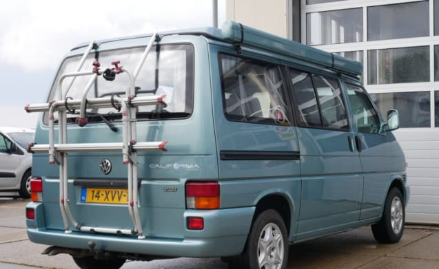 VW bus camper T4 with awning, 4 person sleeping places and bicycle rack