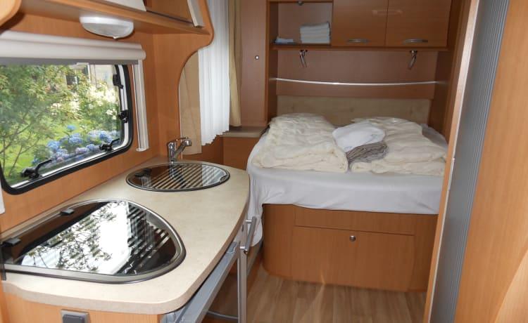 Luxe camper met Queensbed