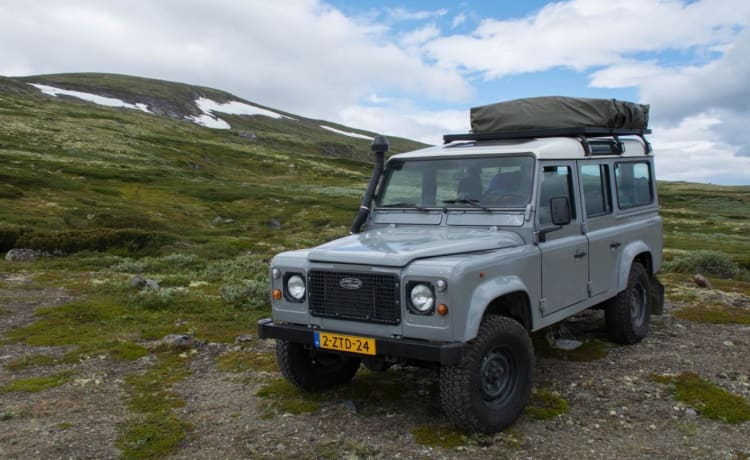 Land Rover Defender 110 with roof tent
