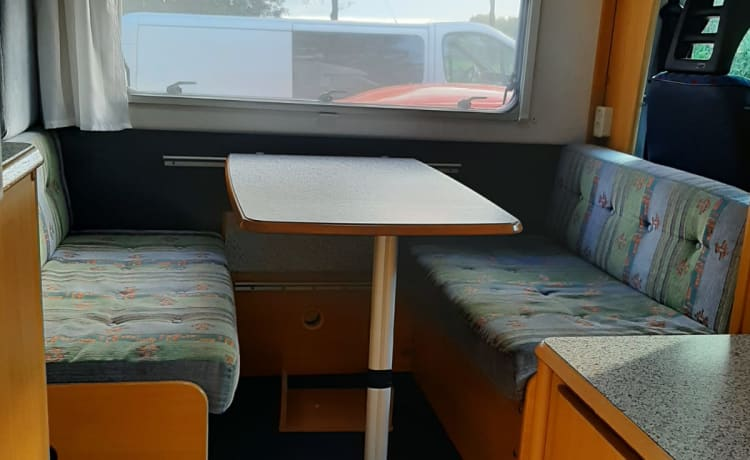 fully furnished dethleffs camper is boarding and driving away