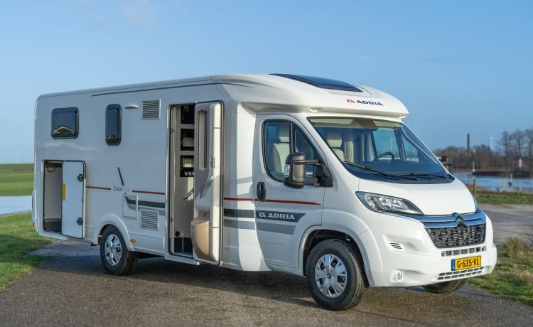 New and very luxurious Adria Coral, length beds, lots of light and storage space,