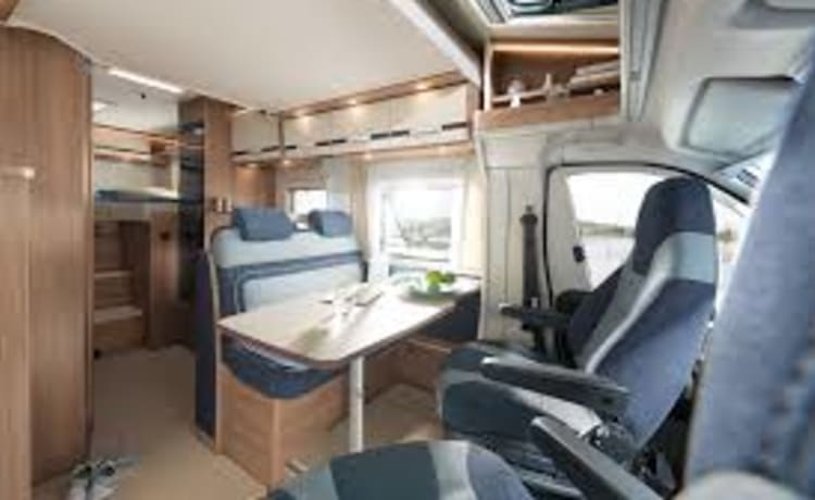 Luxury Dethleffs Trend T 6717 with 2 single beds and pull-down bed.