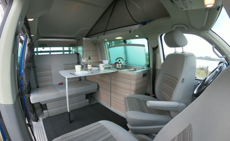 Volkswagen T5 California Bus camper with pop-top roof.