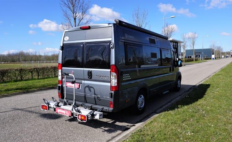 Luxe Globecar (Pössl) + lengtebedden en complete inventaris
