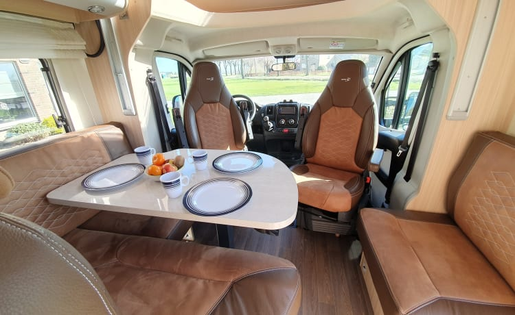 luxury camper including queen-size bed, pull-down bed and large garage and tow bar