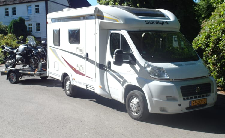 lovely compact camper with towbar