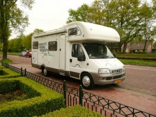 Hymer Camp GT family camper with crossbed on garage, equipped with towbar!