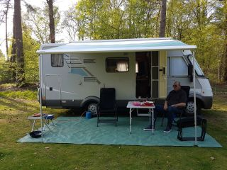 Luxury Hymer B524 integral with engine air conditioning, garage, lift bed and cross bed.