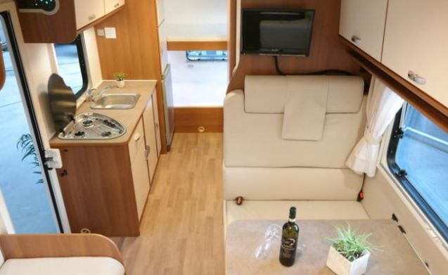 G-type – Modern spacious camper with 200 free extras, TV, complete kitchen and garden furniture