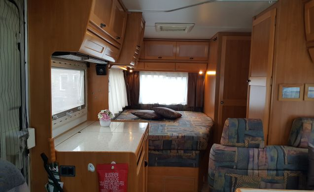 2 person Hymer integral camper with fixed bed, plenty of living and cupboard space.