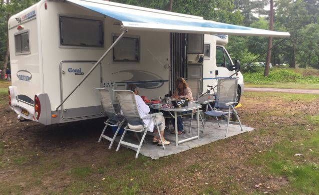 With the dog on holiday in this spacious 4-person Adria Camper