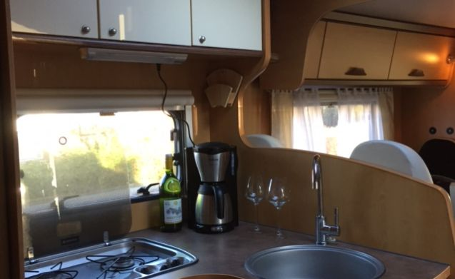 Spacious Luxury Camper with many comforts.