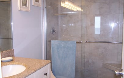 Private master suite bathroom with large tiled shower