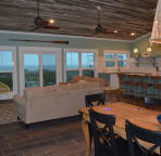 Spacious kitchen, living and dining room with tons of windows and unobstructed views of the Gulf.
