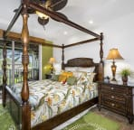 Master bedroom outfitted with a cal king 4 poster bed and exquisite Tommy Bahama bedding.