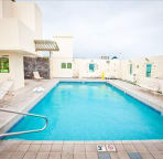 The rooftop pool has a covered entertaining area for your enjoyment.