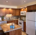 Fully equipped kitchen with large and small appliances.