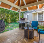 Peaceful garden side lanai with new Weber BBQ and hanging chair. Another perfect place to read and relax.