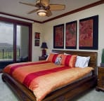 Master Bedroom with golf course views from its lanai. King size bed