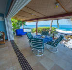 """The """"disappearing"""" wall between the living room and lanai is outdoor living at its best."""