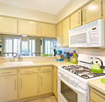 Cozy kitchen with updated appliances and quality implements and gadgets.