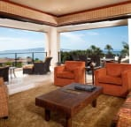 Living room and spacious corner unit deck and panoramic ocean view