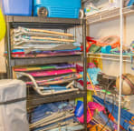 Ground floor storage closet with beach chairs, cooler, umbrella, toys and more