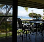 View from living room out to lanai and Kama'ole II Beach