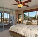 Master bedroom with private lanai & partial ocean view