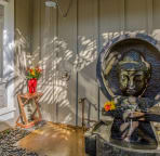A Balinese stone fountain greets your arrival at Surf Song