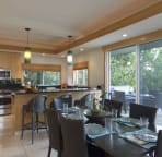 open dining area and kitchen with bar.  Sliding doors to lanai